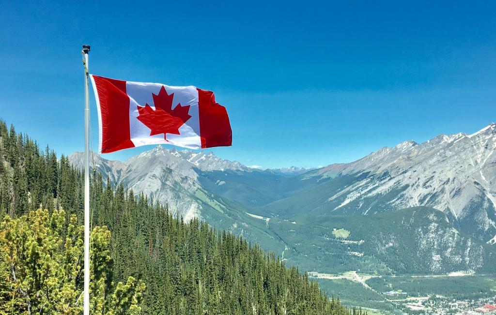 canada flag with mountain range